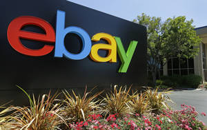 Photo - This Tuesday, July 16, 2013 photo shows an eBay sign at eBay headquarters in San Jose, Calif. Ebay Inc. reports earnings after the U.S. stock market closes on Wednesday, Jan. 22, 2014. (AP Photo/Ben Margot)