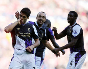 Photo - Liverpool's Luis Suarez, left, celebrates after scoring his goal during their English Premier League soccer match against Sunderland at the Stadium of Light, Sunderland, England, Sunday, Sept. 29, 2013. (AP Photo/Scott Heppell)