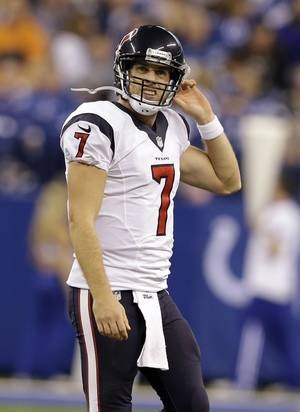 Photo - Houston Texans quarterback Case Keenum walks off the field during the second half of an NFL football game against the Indianapolis Colts in Indianapolis, Sunday, Dec. 15, 2013. (AP Photo/Darron Cummings)