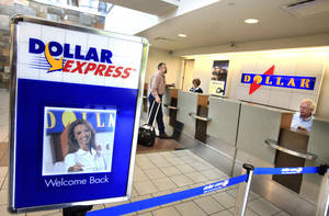 Photo - Dollar Thrifty counters are shown at Will Rogers World Airport. Photo by Jim Beckel, The Oklahoman