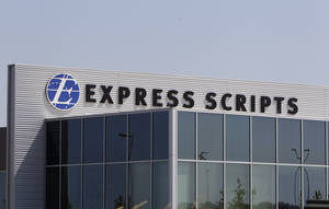 Photo - FILE - This July 21, 2011, file photo shows a building on the Express Scripts campus in Berkeley, Mo. Express Scripts Holding Co. reports quarterly financial results after the market closes on Thursday, Feb. 20, 2014. (AP Photo/Jeff Roberson, File)