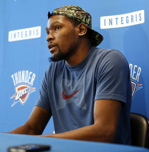 Photo - Kevin Durant speaks during exit interviews with the media for the Oklahoma City Thunder at the team's practice facility in Oklahoma City, Sunday, June 1, 2014. PHOTO BY NATE BILLINGS, The Oklahoman