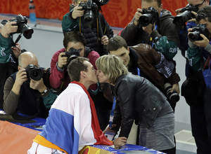 Photo - Photographers shoot Stefan Groothuis of the Netherlands being congratulated after winning the gold in the men's 1,000-meter speedskating race at the Adler Arena Skating Center at the 2014 Winter Olympics in Sochi, Russia, Wednesday, Feb. 12, 2014. (AP Photo/Patrick Semansky)