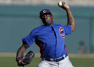 photo - Chicago Cubs pitcher Dontrelle Willis throws against the Los Angeles Dodgers in the eighth inning of a exhibition spring training baseball game in Glendale, Ariz., Monday, Feb. 25, 2013. (AP Photo/Paul Sancya)