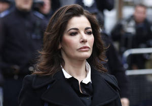 Photo - Celebrity chef, Nigella Lawson, arrives at Isleworth Crown Court in London, Wednesday, Dec. 4, 2013. Celebrity chef Nigella Lawson could face questions Wednesday about alleged drug use when she appears as a witness at the fraud trial of her former personal assistants.  Lawson is due to testify as a prosecution witness against Italian sisters Elisabetta and Francesca Grillo. The pair are accused of living the high life by using credit cards loaned to them by Lawson and her ex-husband Charles Saatchi.  (AP Photo/Sang Tan)