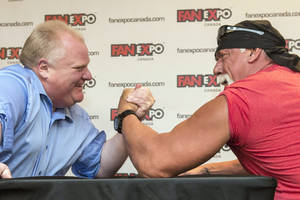 Photo - Toronto City Mayor Rob Ford, left, takes on professional wrestler Hulk Hogan in an arm-wrestling match to promote Fan Expo in Toronto on Friday, Aug. 23, 2013 . (AP Photo/The Canadian Press, Chris Young)