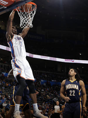 Photo - Oklahoma City's Perry Jones (3) dunks in front of Indiana's Chris Copeland (22) during the NBA game between the Oklahoma City Thunder and the Indiana Pacers at the Chesapeake Energy Arena, Sunday, Dec. 8, 2013. PHOTO BY SARAH PHIPPS, The Oklahoman