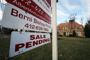 Photo - This March 5, 2013, photo, shows a sale pending sign in Mt. Lebanon, Pa. Average U.S. rates on fixed mortgages crept closer to their historic lows this week, a trend that could help the housing recovery strengthen.(AP Photo/Gene J. Puskar)