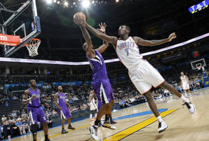 Photo - The Thunder's Royal Ivey (7) battles for a rebound with the Kings' Donte Greene (20) during the NBA basketball game between the Oklahoma City Thunder and The Sacramento Kings on Tuesday, Feb. 15, 2011, Oklahoma City Okla.  Photo by Chris Landsberger, The Oklahoman