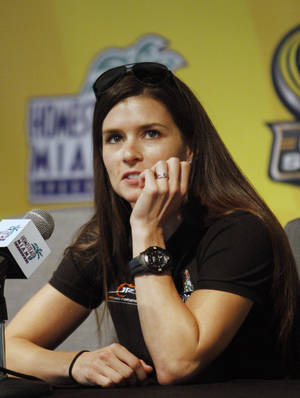 Photo -   NASCAR driver Danica Patrick talks to the media about her career, Friday, Nov. 16, 2012 at the Homestead-Miami Speedway in Homestead, Fla. (AP Photo/David Graham)