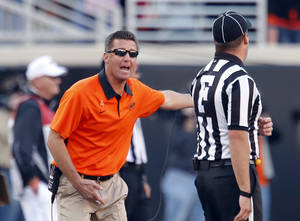 Photo - Oklahoma State head coach argues with a referee during a college football game between Oklahoma State University and the Texas Tech University (TTU) at Boone Pickens Stadium in Stillwater, Okla., Saturday, Nov. 17, 2012. Photo by Sarah Phipps, The Oklahoman
