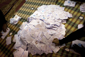 photo - Egyptian election workers count ballots at the end of the second round of a referendum on a disputed constitution drafted by Islamist supporters of president Mohammed Morsi at a polling station in Giza, Egypt, Saturday, Dec. 22, 2012. Egypt&#039;s Islamist-backed constitution headed toward likely approval in a final round of voting on Saturday, but the deep divisions it has opened up threaten to fuel continued turmoil. (AP Photo/Nasser Nasser)