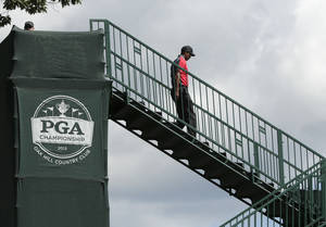 Photo - Tiger Woods walks to the first tee during the final round of the PGA Championship golf tournament at Oak Hill Country Club, Sunday, Aug. 11, 2013, in Pittsford, N.Y. (AP Photo/Charlie Riedel)