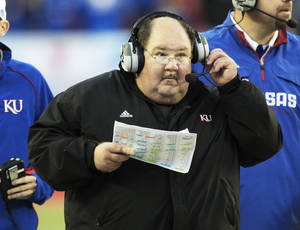Photo - Former Kansas coach Mark Mangino. AP photo
