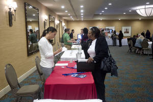 Photo - In this Friday, Nov. 30, 2012 photo, a person fills out an application at the Fort Lauderdale Career Fair, in Dania Beach, Fla. The U.S. economy added a solid 146,000 jobs in November and the unemployment rate fell to 7.7 percent, the lowest since December 2008, the Labor Department announced Friday, Dec. 7, 2012. The government said Superstorm Sandy had only a minimal effect on the figures. (AP Photo/J Pat Carter)