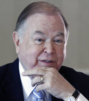 photo - FILE - In this May 12, 2011, file photo, David Boren, president of the University of Oklahoma, speaks during a meeting of the university's Board of Regents in Norman, Okla. A person with knowledge of the situation says Texas and Oklahoma officials met over the weekend amid speculation that the Sooners are considering leaving the Big 12. (AP Photo/Sue Ogrocki, File) ORG XMIT: OKSO112