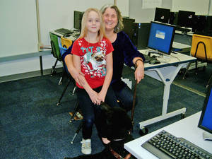 Photo - Susan Barker, who is blind, volunteers  at her childrens' school, Will Rogers Elementary in Edmond, bringing along Jenny, her guide dog. Her daughter Elana is 9. Photo by Steve Gust, for The Oklahoman <strong>Steve Gust</strong>