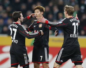 Photo - Leverkusen's Son Heung-min Son of South Korea , center, celebrates with Leverkusen's Gonzalo Castro, left, and Leverkusen's Stefan Kiessling after scoring  during the German first division Bundesliga soccer match between Borussia Moenchengladbach and Bayer 04 Leverkusen in Moenchengladbach, Germany, Friday, Feb. 7, 2014. (AP Photo/Frank Augstein)