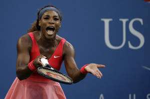 Photo - Serena Williams reacts after losing a point to Li Na, of China, during the semifinals of the 2013 U.S. Open tennis tournament, Friday, Sept. 6, 2013, in New York. (AP Photo/David Goldman)