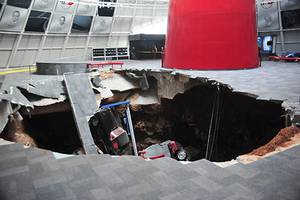 Photo - In this image provided by the National Corvette Museum shows several cars that collapsed into a sinkhole Wednesday, Feb. 12, 2014, in Bowling Green, Ky. The museum said a total of eight cars were damaged when a sinkhole opened up early Wednesday morning inside the museum. (AP Photo/National Corvette Museum, HO)