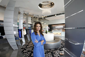 photo - Danielle Keogh is owner of Liberte, a new boutique opening Friday in the Classen Curve shopping center. She has gathered designer clothing from around the world during her travels as a defense contractor. Photos by Jim Beckel, THE OKLAHOMAN