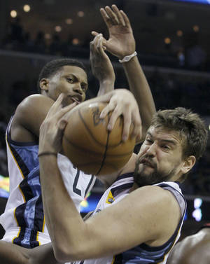Photo -   Memphis Grizzlies' Marc Gasol, of Spain, right, gets a defensive rebound around Memphis Grizzlies' Rudy Gay during the first half of an NBA basketball game in Memphis, Tenn., Sunday, Nov. 11, 2012. (AP Photo/Danny Johnston)