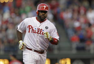 Photo - Philadelphia Phillies' Ryan Howard runs the bases on his home run in the first inning of a baseball game against the Washington Nationals, Saturday, May 3, 2014, in Philadelphia. (AP Photo/Laurence Kesterson)