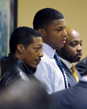 Photo - FILE - in a file photo made Sunday, March 17, 2013,   Ma'lik Richmond, center, stands with his father, Nathaniel Richmond, left, and attorney Walter Madison after he and co-defendant Trent Mays, 17, were found delinquent on rape and other charges in juvenile court in Steubenville, Ohio. Ma'lik Richmond has been released from a juvenile detention center less than a year after his conviction for raping a 16-year-old girl following an alcohol-fueled party. (AP Photo/Keith Srakocic, Pool, file)