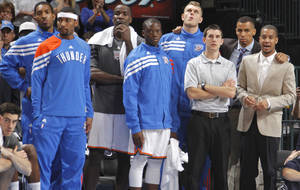 photo - The Thunder bench looks on in the final seconds during the NBA basketball game between the Oklahoma City Thunder and the Phoenix Suns at the Chesapeake Energy Arena on Wednesday, March 7, 2012 in Oklahoma City, Okla.  Photo by Chris Landsberger, The Oklahoman