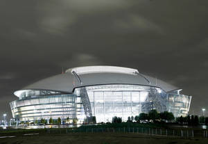 Photo - OU and BYU will begin the season Saturday at the Dallas Cowboys new stadium in Arlington, Texas. AP photo