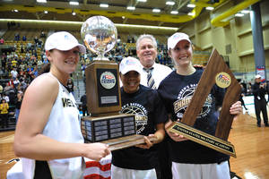 Photo - Army women's basketball team captains, from left in the foreground, Jen Hazlett, Jordan Elliott and Olivia Schretzman, and head coach Dave Magarity, background, stand for a portrait after winning the NCAA college basketball game in the Patriot League Championship game against Holy Cross at Christi Arena, Saturday, March 15, 2014, at West Point, N.Y. Army won 68-58. (AP Photo/Karl Rabe)
