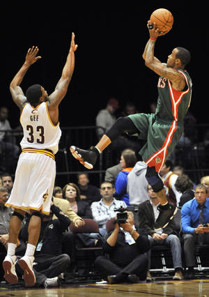 Photo -   Milwaukee Bucks guard Monta Ellis, right, shoots over Cleveland Cavaliers guard Alonzo Gee during the first quarter of a preseason NBA basketball game, Tuesday, Oct. 9, 2012, in Canton, Ohio. (AP Photo/David Richard)