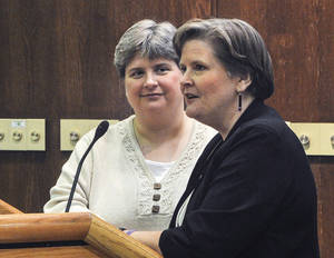 Photo - In this Oct. 10, 2013 photo, Sharon Baldwin, left, and Mary Bishop speak at East Central University in Ada, OK, as part of the ECU Gay-Straight Alliance's National Coming Out Day event.  (AP Photo/Eric Turner) <strong>Eric Turner</strong>