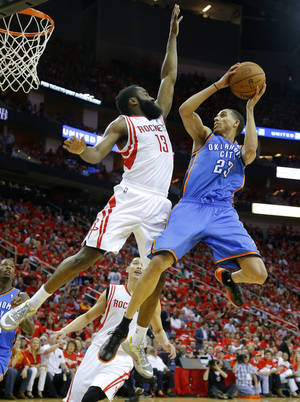 Photo - Oklahoma City's Kevin Martin (23) goes drives to the basket beside Houston's James Harden (13) during Game 6 in the first round of the NBA playoffs between the Oklahoma City Thunder and the Houston Rockets at the Toyota Center in Houston, Texas, Friday, May 3, 2013. Photo by Bryan Terry, The Oklahoman