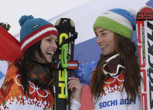 Photo - Women's giant slalom winners Austria's Anna Fenninger (silver), left, and Slovenia's Tina Maze (gold), right, pose for photographers on the podium at the Sochi 2014 Winter Olympics, Tuesday, Feb. 18, 2014, in Krasnaya Polyana, Russia.(AP Photo/Gero Breloer)