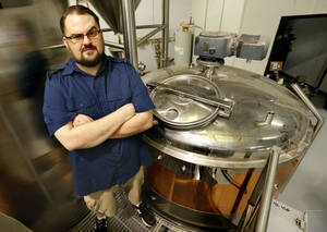 Photo - Matt Anthony, brewmaster with Anthem Brewery, has seen a delay in his federal licensing because of the government shutdown. PHOTO BY STEVE SISNEY, THE OKLAHOMAN <strong>STEVE SISNEY - THE OKLAHOMAN</strong>