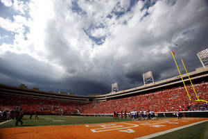 Photo - Storm clouds build during the first half of the college football game between the Oklahoma State University Cowboys (OSU) and the University of Kansas Jayhawks (KU) at Boone Pickens Stadium in Stillwater, Okla., Saturday, Oct. 8, 2011. Photo by Sarah Phipps, The Oklahoman