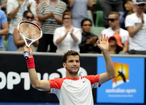 Photo - Grigor Dimitrov of Bulgaria celebrates his win over Milos Raonic of Canada during their third round match at the Australian Open tennis championship in Melbourne, Australia, Saturday, Jan. 18, 2014.(AP Photo/Andrew Brownbill)