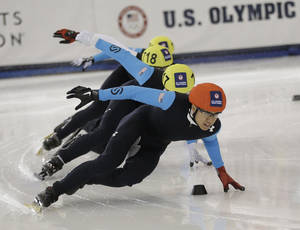 Photo - J.R. Celski, right, leads the pack as he competes in the men's 500 meters during the U.S. Olympic U.S. short track speedskating trials Saturday, Jan. 4, 2014, in Kearns, Utah. (AP Photo/Rick Bowmer)
