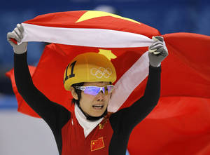 Photo - Li Jianrou of China celebrates winning the women's 500m short track speedskating final at the Iceberg Skating Palace during the 2014 Winter Olympics, Thursday, Feb. 13, 2014, in Sochi, Russia. (AP Photo/Vadim Ghirda)