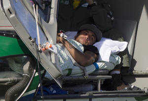Photo - Brazil's Neymar lies inside a medical helicopter at the Granja Comary training center, in Teresopolis, Brazil, Saturday, July 5, 2014. Neymar was airlifted from Brazil's training camp Saturday and will be treated at home for his back injury. Neymar, the biggest football star in Brazil, was ruled out of the rest of the World Cup after fracturing his third vertebra during Friday's 2-1 quarterfinal win over Colombia. (AP Photo/Leo Correa)