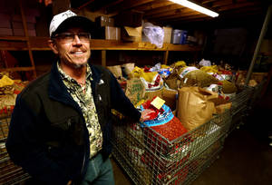 photo - Brett Mason with Mason's Pecans & Peanuts shows bags of pecans brought in by customers for cracking. PHOTO BY STEVE SISNEY, THE OKLAHOMAN <strong>STEVE SISNEY</strong>