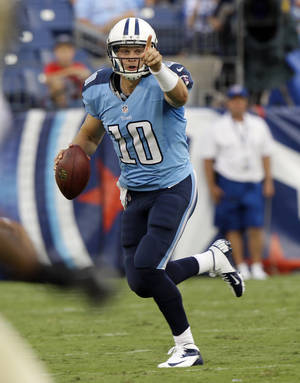 photo -   Tennessee Titans quarterback Jake Locker directs a receiver as he rolls out against the New Orleans Saints in the first quarter of an NFL football preseason game on Thursday, Aug. 30, 2012, in Nashville, Tenn. (AP Photo/Wade Payne)