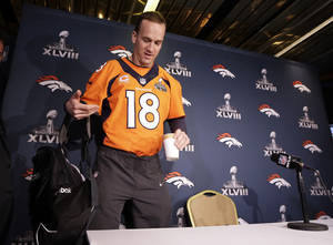Photo - Denver Broncos quarterback Peyton Manning arrives for a news conference Wednesday, Jan. 29, 2014, in Jersey City, N.J. The Broncos are scheduled to play the Seattle Seahawks in the NFL Super Bowl XLVIII football game Sunday, Feb. 2, in East Rutherford, N.J. (AP Photo/Mark Humphrey)