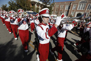 Photo - OU: Bennett Oden plays trumpet with the Pride of Oklahoma Marching Band during the University of Oklahoma Homecoming Parade in Norman, Okla., Saturday, Oct. 20, 2012.  Photo by Garett Fisbeck, The Oklahoman