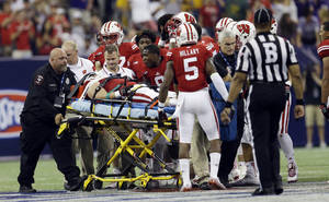 Photo - Wisconsin's Konrad Zagzebski is taken off the field on a stretcher during the first half of an NCAA college football game against LSU Saturday, Aug. 30, 2014, in Houston. (AP Photo/David J. Phillip)