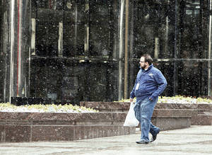 Photo - Snow falls Monday at Leadership Square in downtown Oklahoma City. By Paul Hellstern, The Oklahoman