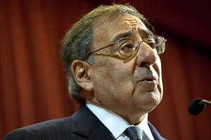 "Photo - U.S. Defense Secretary Leon Panetta speaks about the situation in Algeria, at the start of his remarks at King's College in London on Friday, Jan. 18, 2013, saying there will be ""no quarter for terrorists in North Africa."" (AP Photo/Jacquelyn Martin)"