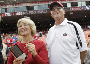 photo - FILE- In this Sept. 11, 2011 file photo, Jackie and Jack Harbaugh, parents of San Francisco 49ers coach Jim Harbaugh and Baltimore Ravens coach John Harbaugh, stand before an NFL football game between the 49ers and the Seattle Seahawks in San Francisco.  The entire Harbaugh family already got its Super Bowl victory last Sunday, when each coach did his part to ensure a family reunion in New Orleans next week. The Ravens face off against the 49ers in the first Super Bowl coached by siblings on opposite sidelines. (AP Photo/Paul Sakuma, file)