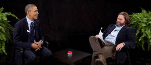 "Photo - This image from video released by Funny Or Die shows President Obama, left, with actor-comedian Zach Galifianakis during an appearance on ""Between Two Ferns,"" the digital short with a laser focus on reaching people aged 18 to 34. Obama's appearance posted Tuesday, March 11, 2014, on the comic website Funny or Die, is at 15 million views by Friday. (AP Photo/Funny Or Die)"